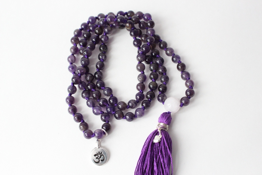 Close up of Amethyst & Rose Quartz Mala