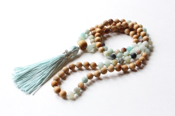 Close up of matte Amazonite & Aromatic Cedar Wood Mala